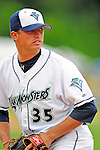 25 July 2010: Vermont Lake Monsters pitcher Dustin Crane warms up in the bullpen during a game against the Tri-City ValleyCats at Centennial Field in Burlington, Vermont. The ValleyCats came from behind to defeat the Lake Monsters 10-8 in NY Penn League action. Mandatory Credit: Ed Wolfstein Photo