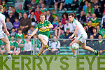 Darran O'Sullivan gets the ball past Pa Ranahan in the Muster Senior Semi final held in The Gaelic Grounds last Saturday evening.