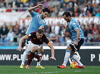 Calcio, Serie A: Roma vs Lazio. Roma, stadio Olimpico, 8 novembre 2015.<br /> Roma's Edin Dzeko, center, is challenged by Lazio's Senad Lulic, left, and Marco Parolo during the Italian Serie A football match between Roma and Lazio at Rome's Olympic stadium, 8 November 2015.<br /> UPDATE IMAGES PRESS/Isabella Bonotto