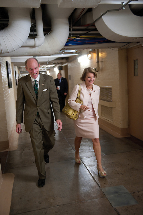 UNITED STATES - JULY 27:  Thaddeus McCotter, R-MI., and Shelly Moore Capito, R-WV., walk to the meeting of the House Republican Caucus in the U. S Capitol.  (Photo By Douglas Graham/Roll Call)