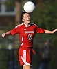 St. John the Baptist No. 6 Marguerite Varley makes a header during a CHSAA varsity girls' soccer game against host Sacred Heart Academy on Monday, October 5, 2015. Sacred Heart won by a score of 3-1.<br /> <br /> James Escher
