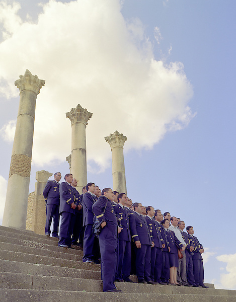 Members of the Moroccan Airforce pose for a group portrait at Volubilis; Roman ruins in the Meknes Province in Northern Morocco. North Africa.