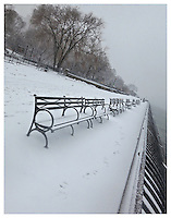 NEW YORK, NY - FEBRUARY 8: Snowy benches in Carl Schurz Park along FDR Drive in Yorkville, New York on February 8, 2013.