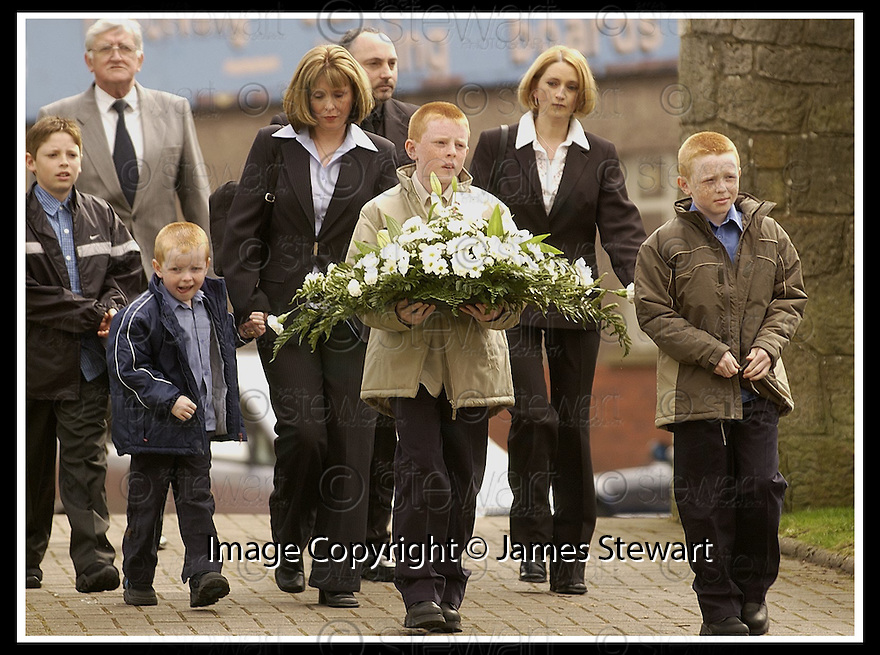 15/11/02       Copyright Pic : James Stewart                     .File Name : stewart-linn family 01.12TH APRIL 2002 : KATHLENN LINN ARRIVES AT THE MEMORIAL SERVICE FOR GARY LINN AT KILSYTH PARISH CHURCH WITH HER THREE SONS SHAUN, CHRISTOPHER (FLOWERS) AND DAVID........... OWEN ANDERSON IS CURRENTLY ON TRIAL AT GLASGOW HIGH COURT CHARGED WITH HIS MURDER.......James Stewart Photo Agency, 19 Carronlea Drive, Falkirk. FK2 8DN      Vat Reg No. 607 6932 25.Office : +44 (0)1324 570906     .Mobile : + 44 (0)7721 416997.Fax     :  +44 (0)1324 570906.E-mail : jim@jspa.co.uk.If you require further information then contact Jim Stewart on any of the numbers above.........