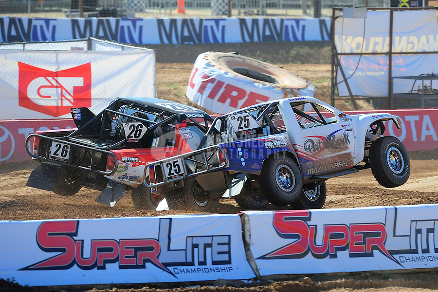 Apr 16, 2011; Surprise, AZ USA; LOORRS driver Wyatt Kirchner (26) races alongside Patrick Clark (25) during round 3 at Speedworld Off Road Park. Mandatory Credit: Mark J. Rebilas-.