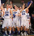 SIOUX FALLS, SD - MARCH 17: St. Thomas More's Jeremy Henderson leads the team in celebration of the Cavaliers 63-56 victory over Dakota Valley for the 2012 Class A Boys Basketball Championship Saturday night at the Sioux Falls Arena. (Photo by Dave Eggen/Inertia)