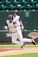 Micah Johnson (3) of the Winston-Salem Dash attempts to lay down a bunt against the Myrtle Beach Pelicans at BB&T Ballpark on July 7, 2013 in Winston-Salem, North Carolina.  The Pelicans defeated the Dash 6-5 in 8 innings in game two of a double-header.  (Brian Westerholt/Four Seam Images)