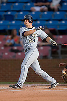 Jason Haniger #29 of the Georgia Tech Yellow Jackets follows through on his swing versus the Wake Forest Demon Deacons at Wake Forest Baseball Park April 18, 2009 in Winston-Salem, NC. (Photo by Brian Westerholt / Four Seam Images)