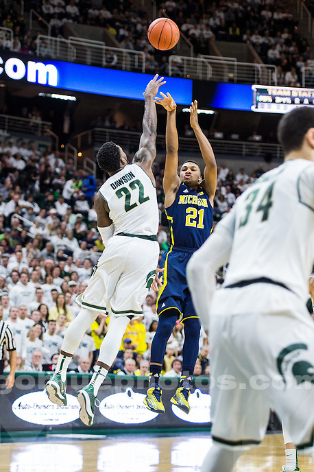 The University of Michigan men's basketball team falls to Michigan State, 76-66 (OT), at the Breslin Center in East Lansing on February 2, 2015.