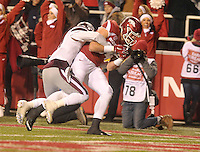 NWA Democrat-Gazette/MICHAEL WOODS • University of Arkansas tight end Hunter Henry pulls in a touchdown catch in front of Mississippi State defender Kivon Coman in the 3rd quarter of Saturday nights game at Razorback Stadium November 21, 2015.