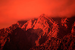 A sunset turns the Wasatch Mountains into an unnatural red hue near Ben Lomond Peak in Utah. Colin Braley/Photo