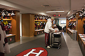 John O'Donnell (Harvard - Equipment Manager) folds socks as he prepares the men's room for their game that night. - Harvard University celebrated the official opening of the newly renovated Bright-Landry Hockey Center on Saturday, November 1, 2014,  in Cambridge, Massachusetts.