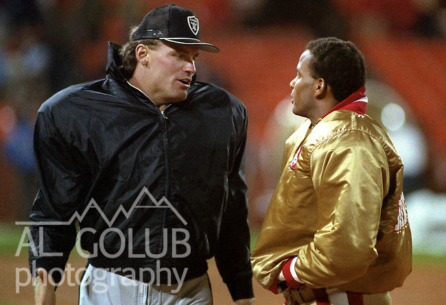 San Francisco 49ers vs. Los Angles Raiders at Candlestick Park Saturday, August 4, 1984..Pre-season Game. .Los Angles Raiders Defensive End Howie Long (75) and San Francisco 49ers Defensive Back Ronnie Lott (42) talk after game...