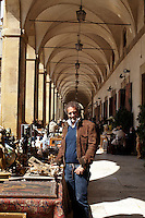 Antonello Radi spots a bargain on one of the stands in the outdoor antiques fair in Foligno