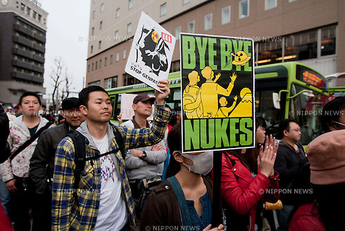 Tokyo, Japan - A photo made available on April 11 shows protestors holding up anti-nuclear signs during a rally in the Koenji district part of Tokyo as part of a global call for solidarity actions against nuclear plants, 10 April 2011. (Photo by Christopher Jue/AFLO) [2331]