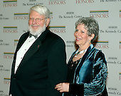 Theodore Bikel and Tamara Brooks arrive for the State Department Dinner for the 29th Kennedy Center Honors dinner at the Department of State in Washington, D.C. on Saturday evening, December 2, 2006.  Andrew Lloyd Webber, Zubin Mehta, Dolly Parton, Smokey Robinson and Stephen Spielberg are being honored in 2006 for their contribution to American culture.  Mr. Bikel passed away in Los Angeles on Tuesday, July 21, 2015 at the age of 91.<br /> Credit: Ron Sachs / CNP