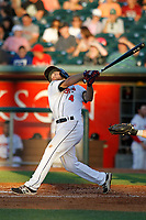 Lansing Lugnuts shortstop Vinny Capra (4) follows through on a swing during a game against the Dayton Dragons at Cooley Law School Stadium on August 10, 2018 in Lansing, Michigan. Lansing defeated Dayton 11-4.  (Robert Gurganus/Four Seam Images)