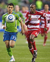 Dallas FC midfielder Jackson Goncalves, right and Seattle Sounders FC forward Fredy Montero chase down the ball during play at Qwest Field in Seattle Saturday May 14, 2011. Dallas won the game 1-0.