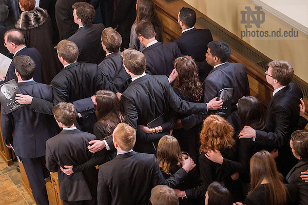 Mar. 4, 2015; Students sing the Alma Mater in the Basilica of the Sacred Heart at the end of the funeral Mass for President Emeritus Rev. Theodore M. Hesburgh, C.S.C.. (Photo by Matt Cashore/University of Notre Dame)