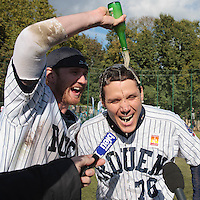 24 October 2010: Boris Marche of Rouen celebrates with Aaron Hornostaj as he answers journalists as Rouen defeats 5-1 Savigny, during game 4 of the French championship finals, in Rouen, France. Rouen wins his 7th French Championship in 8 years.