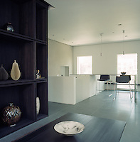 A small informal eating area is situated next to the dining room and adjacent to the kitchen
