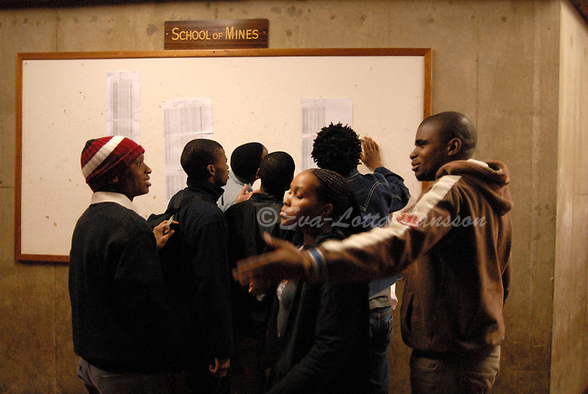 Mining students at the University of Johannesburg check test results posted on a board. ..