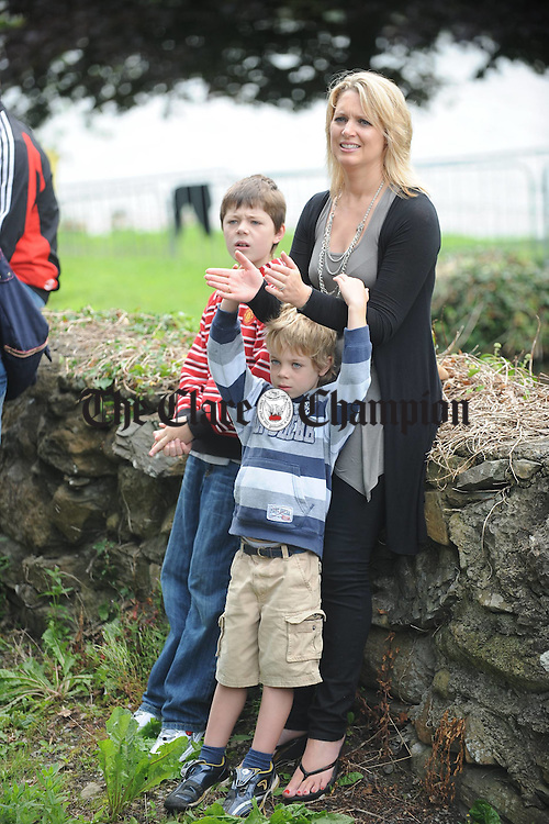 Caroline Fitzgerald keeping an eye on all the action with sons Harry and Luka during the Brian Boru Sprint Triathlon at Two-Mile-Gate,  Killaloe. Photograph by John Kelly.
