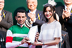 Brazilian jockey Joao Moreira (L) who rode Neorealism receives a trophy after winning the Audemars Piguet QEII Cup horse race at Sha Tin race course in Hong Kong, China. (Photo by Marcio Rodrigo Machado / Power Sport Images)