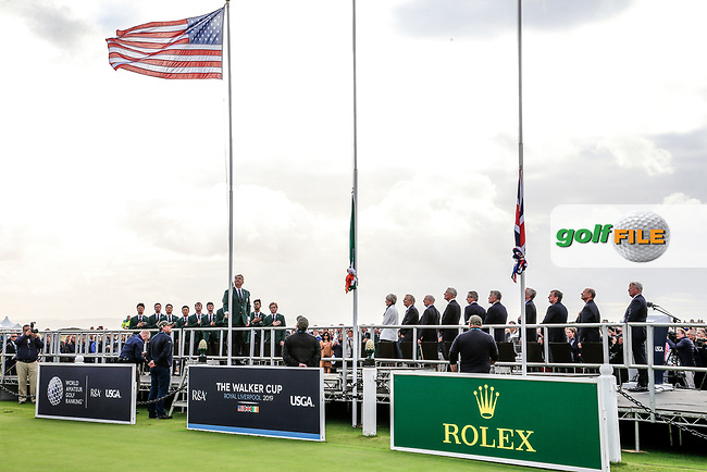 Nathaniel Crosby (GB&I Captain) raises the USA flag during the opening ceremony at the Walker Cup, Royal Liverpool Golf CLub, Hoylake, Cheshire, England. 06/09/2019.<br /> Picture Fran Caffrey / Golffile.ie<br /> <br /> All photo usage must carry mandatory copyright credit (© Golffile | Fran Caffrey)