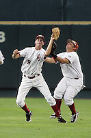 Oklahoma's 2B Danny Black collides with RF Cody Reine in Game 3 of the NCAA Division One Men's College World Series on Sunday June 20th, 2010 at Johnny Rosenblatt Stadium in Omaha, Nebraska.  (Photo by AJ Woolley / Four Seam Images)