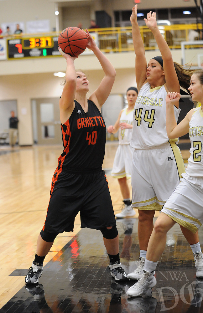 NWA Democrat-Gazette/ANDY SHUPE<br /> Stephanie Pinter (40) of Gravette attempts a shot in the lane as Carlee McClure (44) of Pottsville defends Wednesday, Feb. 24, 2016, during the first half of play in the 4A North Regional Tournament in Tiger Arena in Prairie Grove. Visit nwadg.com/photos to see more photographs from the game.