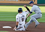 Reno Aces Ryan Budde slides safely into second as Tucson Padres Anthony Contreras can't get the throw during their game on Sunday night, September 2, 2012 at Aces Ballpark in Reno, NV.