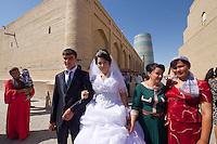 Uzbekistan, Khiva, Ichon-Qala.<br /> Kalta Minor Minaret. Wedding couple.
