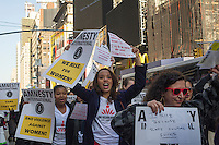 Members of Amnesty International and their supporters rally in Times Square in New York on Thursday, February 14, 2013 in support of the domestic and international Violence Against Women Act (VAWA). The domestic act would extend protection to immigrant, native american and LGBT victims while the international act would make ending violence against women a diplomatic priority for the United States.  (© Frances M. Roberts)
