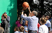 United States President Barack Obama (C) pays basketball during the White House Easter Egg Roll on the South Lawn of the White House March 28, 2016 in Washington, DC. <br /> Credit: Olivier Douliery / Pool via CNP