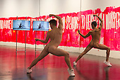 London, UK. 7 October 2015. L-R: Gareth Mole and Paolo Rosini performing naked. Eddie Peake: The Forever Loop opens in the Curve gallery/Barbican Centre on 9 October 2015 and runs until 10 January 2016. In this free exhibition, artist Eddie Peake presents installations, choreographed performance of nude male and female dancers and video set-ups. EDITORIAL USE IN CONNECTION WITH THE EXHIBITION.