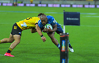 Wes Goosen tries to stop Mark Telea as he runs in a try for the Blues during the Super Rugby match between the Hurricanes and Blues at Sky Stadium in Wellington, New Zealand on Saturday, 7 March 2020. Photo: Dave Lintott / lintottphoto.co.nz