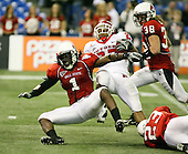 January 5th, 2008:  Ball State defender Eddie Burk (1) is knocked over while attempting to tackle Rutgers running back Ray Rice (27) during the second quarter of the International Bowl at the Rogers Centre in Toronto, Ontario Canada...Rutgers defeated Ball State 52-30.  ..Photo By:  Mike Janes Photography
