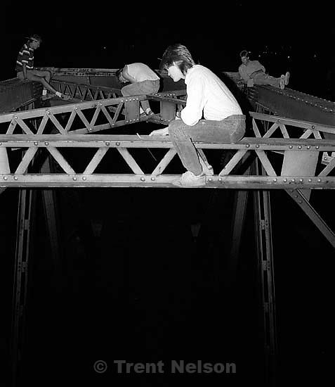 Scott Hubert lights a bottle rocket, Ted Hansen, Alex Van Valin on the Bridge with people throwing matches.  &amp;#xA;<br />