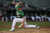 OAKLAND, CA - JUNE 15:  Chris Bassitt #40 of the Oakland Athletics pitches against the Los Angeles Angels of Anaheim during the game at the Oakland Coliseum on Friday, June 15, 2018 in Oakland, California. (Photo by Brad Mangin)
