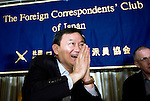 Thaksin Shinawatra, former prime minister of Thailand, greets an attendee of a news conference at the Foreign Correspondents' Club in Tokyo, Japan on 23 Aug. 2011. Photographer: Robert Gilhooly