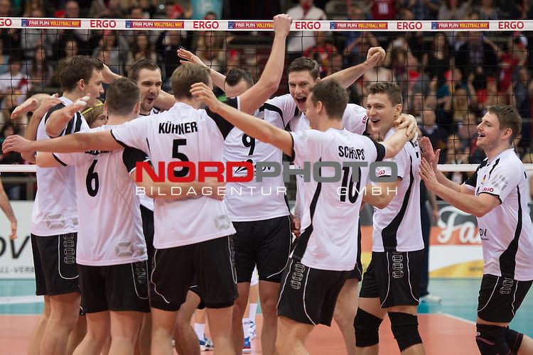 05.01.2014, MHP Arena, Ludwigsburg<br /> Volleyball, Qualifikation WM 2014, Deutschland vs. T&uuml;rkei / Tuerkei<br /> <br /> Jubel Christian Fromm (#1 GER), Denis Kaliberda (#6 GER), Tim Broshog (#15 GER), Sebastian K&uuml;hner / Kuehner (#5 GER), Georg / Gy&ouml;rgy / Gyoergy Grozer (#9 GER) Marcus B&ouml;hme / Boehme (#8 GER), Lukas Kampa (#11 GER), Jochen Sch&ouml;ps / Schoeps (#10 GER), Markus Steuerwald (#2 GER) nach dem Matchball / Sieg<br /> <br />   Foto &copy; nordphoto / Kurth
