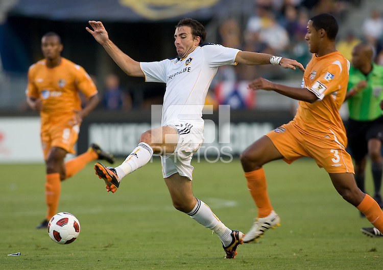 LA Galaxy forward Alan Gordon (21) beats Puerto Islanders Richard Martinez (3) to the ball. The Puerto Rico Islanders defeated the LA Galaxy 4-1 during CONCACAF Champions League group play at Home Depot Center stadium in Carson, California on Tuesday July 27, 2010.