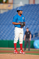 Clearwater Threshers starting pitcher Adonis Medina (18) gets ready to deliver a pitch during a game against the Fort Myers Miracle on May 31, 2018 at Spectrum Field in Clearwater, Florida.  Clearwater defeated Fort Myers 5-1.  (Mike Janes/Four Seam Images)