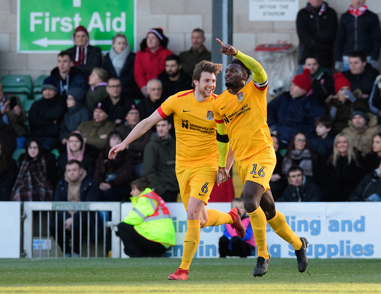 Northampton Town's Aaron Pierre, right, celebrates scoring his side's equalising goal to make the score 1-1 with team-mate Ash Taylor<br /> <br /> Photographer Chris Vaughan/CameraSport<br /> <br /> The EFL Sky Bet League Two - Lincoln City v Northampton Town - Saturday 9th February 2019 - Sincil Bank - Lincoln<br /> <br /> World Copyright &copy; 2019 CameraSport. All rights reserved. 43 Linden Ave. Countesthorpe. Leicester. England. LE8 5PG - Tel: +44 (0) 116 277 4147 - admin@camerasport.com - www.camerasport.com
