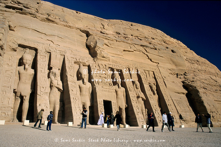 Tourists visiting the Ramses II and Queen Nefertiti Temple at Abu Simbel, Egypt.