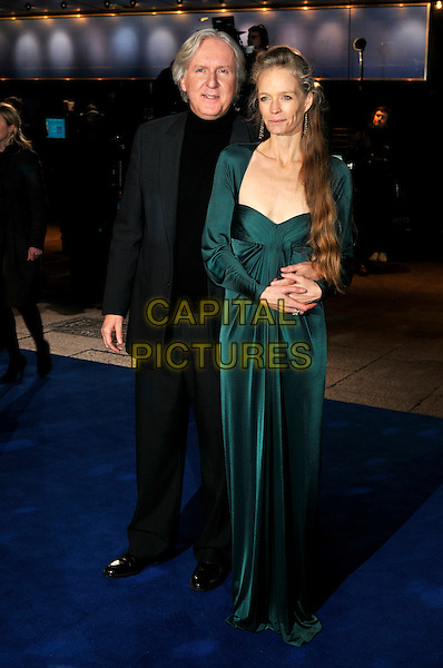 """JAMES CAMERON & SUZY AMIS .Arrivals - World Premiere of """"Avatar"""",  Odeon Leicester Square, London, England, UK, December 10th, 2009..full length black polo neck grey gray suit jacket green dress long maxi sleeved sleeves couple married husband wife .CAP/PL.©Phil Loftus/Capital Pictures."""
