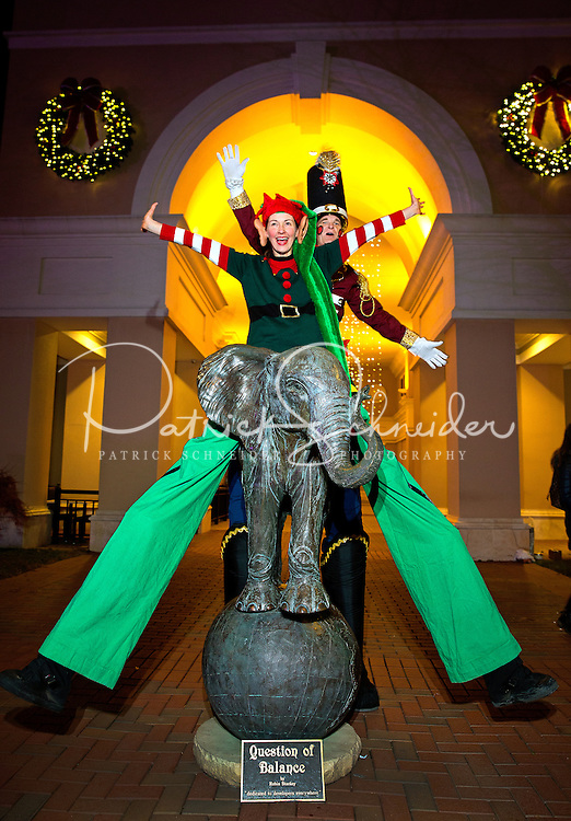 Charlotte Christmas Events - Photography of the Phillips Place Winter Wonderland Christmas event in Charlotte, North Carolina.<br /> <br /> Two holiday stilt walkers having fun entertaining the children at Charlotte holiday Christmas event.<br /> <br /> Charlotte Photographer - PatrickSchneiderPhoto.com