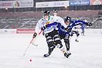 Uppsala 2014-01-12 Bandy  IK Sirius - GAIS Bandy :  <br />  GAIS Anton L&ouml;&ouml;f i kamp om bollen med Sirius Niklas Hellqvist  i sn&ouml;v&auml;dret under matchen <br /> (Foto: Kenta J&ouml;nsson) Nyckelord: