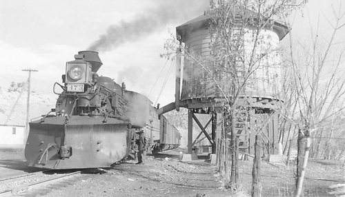 D&amp;RGW #473 (in Grande Gold) with westbound San Juan taking water at Gato.<br /> D&amp;RGW  Gato (Pagosa Junction), CO  Taken by Richardson, Robert W. - 1/22/1951